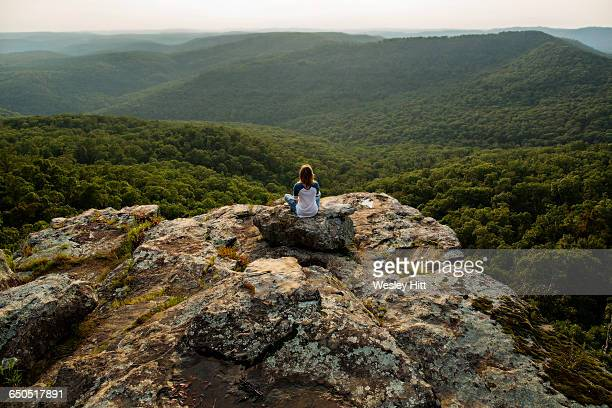 young woman meditates on top of mountain - ozark mountains stock pictures, royalty-free photos & images