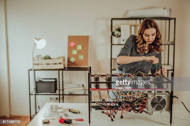 Young woman mining bitcoin and other cryptocurrency