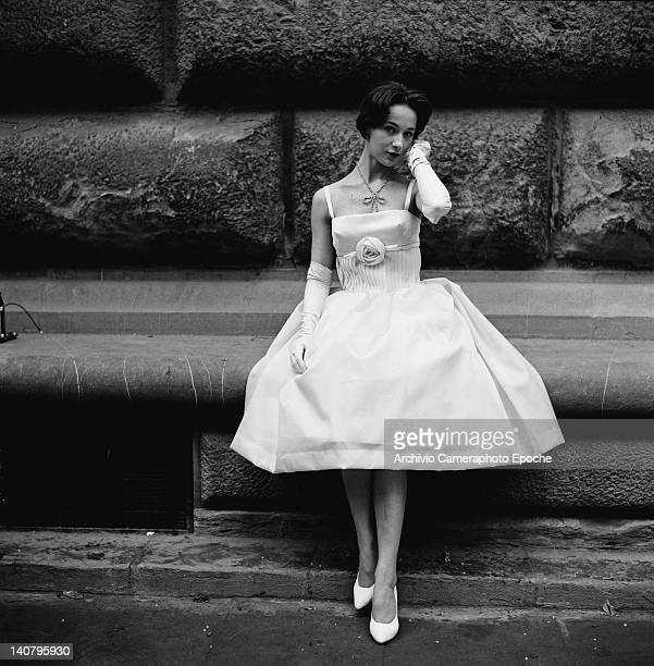 A young woman modelling a dress with a kneelength skirt in a crinoline shape Italy circa 1955