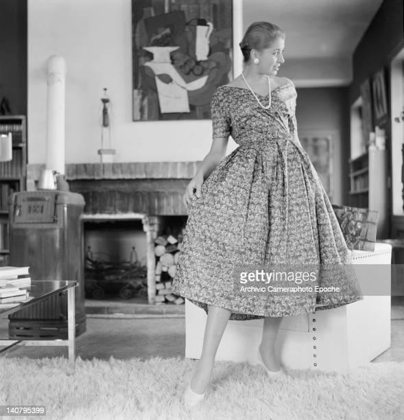 Young woman modelling a three-quarter length day dress, Venice, circa 1955.