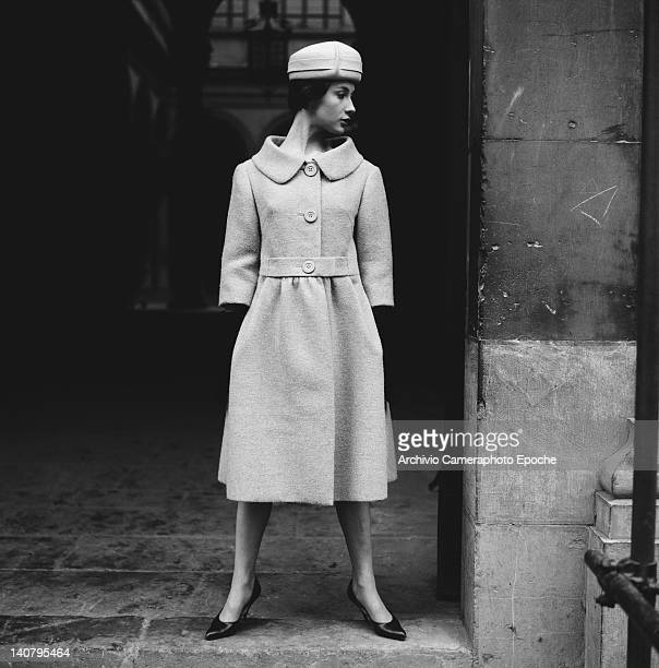 A young woman modelling a threequarter length winter coat with matching hat Italy circa 1955