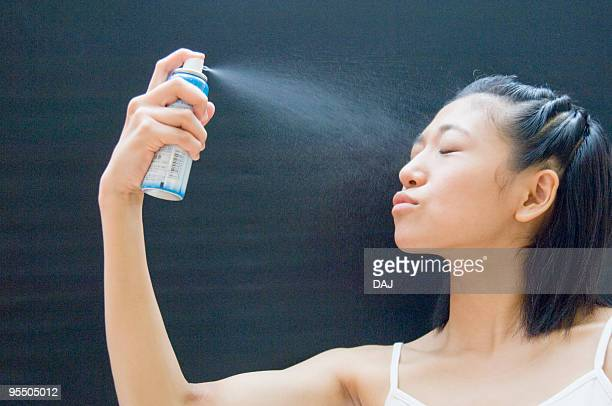 Young Woman Moisturizing Her Face