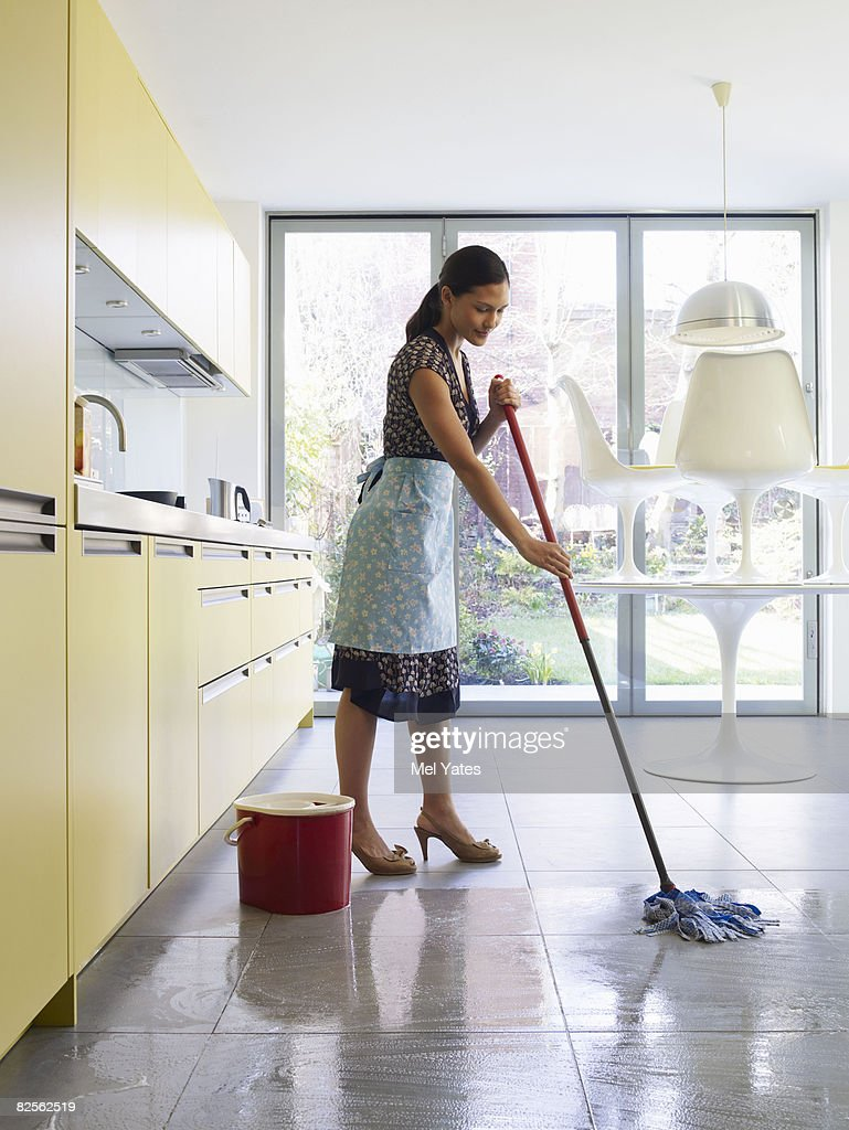 Young Woman Mopping Kitchen Floor Stock Photo | Getty Images