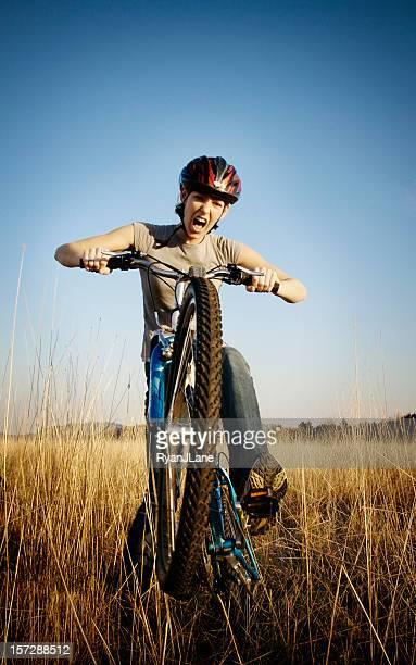 Young Woman Mountain Bike Riding
