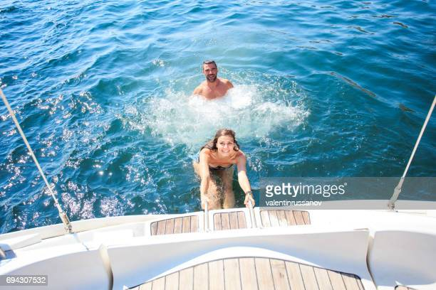 young woman moving up on yacht - yacht foto e immagini stock