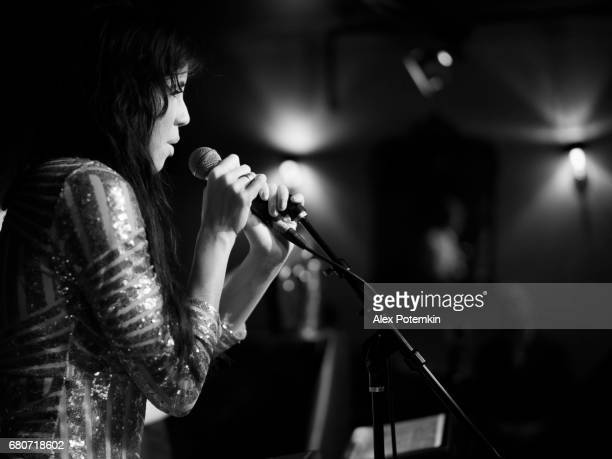 young woman, musician, singer and performer, singing on the stage. - jazz stock pictures, royalty-free photos & images
