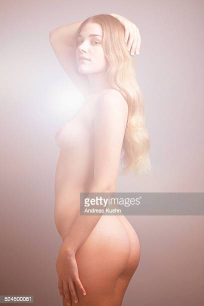 young woman naked in profile position, 3/4 length. - bare bottom stock pictures, royalty-free photos & images