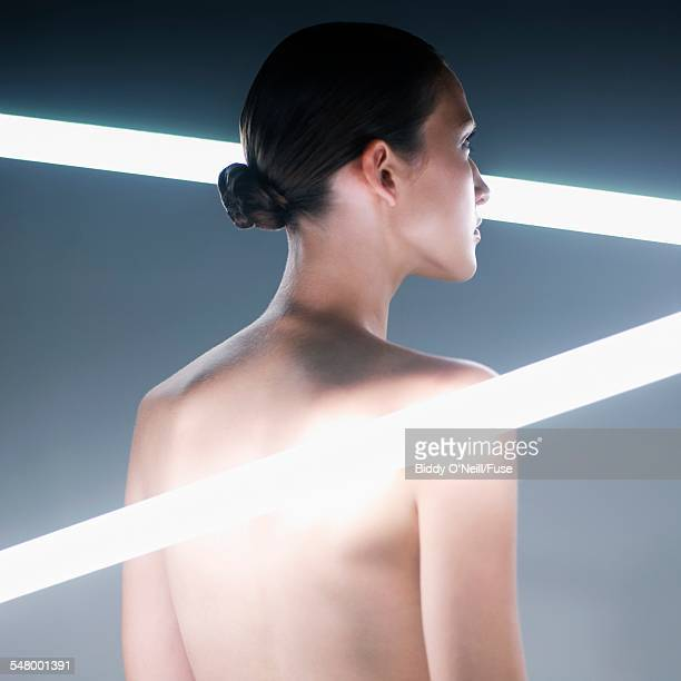 Young Woman Near Neon Lights