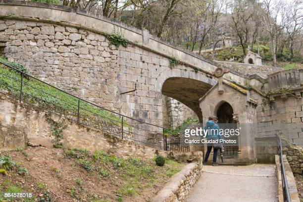 young woman observing the representation of stations of the cross in rocamadour - stations of the cross stock pictures, royalty-free photos & images