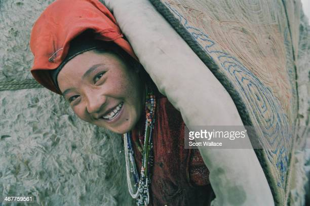 A young woman of a nomadic people emerging from a yurt at an encampment in the Wakhan Corridor of northeastern Afghanistan 2004