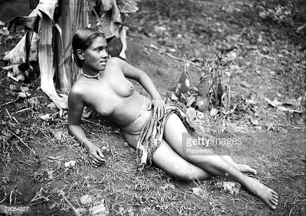 HG Ponting in Asia 1900 1906 India A bare breasted pretty native girl of Ceylon lying down on the grass