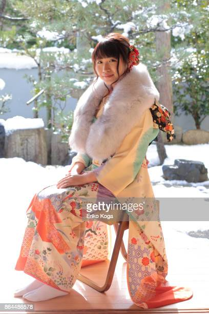 Young woman of coming‐of‐age ceremony sitting on chair