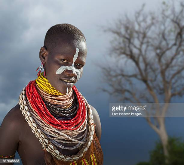 young woman of the karo tribe, omo valley, ethiopia - african tribal face painting stock photos and pictures