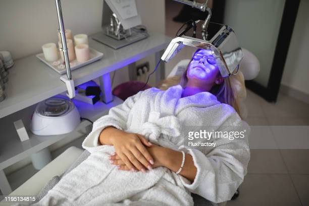 young woman on a anti aging treatment at a spa - uv protection stock pictures, royalty-free photos & images