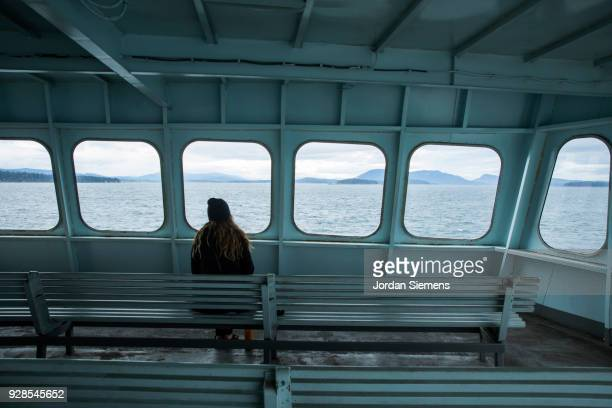 a young woman on a boat - ferry stock pictures, royalty-free photos & images