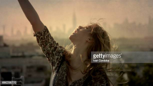 Young woman on a Brooklyn rooftop at sunset