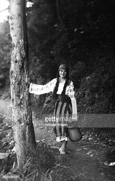 Young woman on a forest path Bistrita Valley Moldavia northeast Romania c1920c1945 Depicting customs and traditional labour in the rural Carpathian...