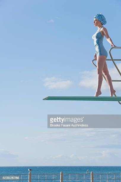 Young woman on a high dive