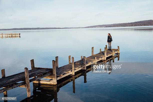 Young woman on a jetty