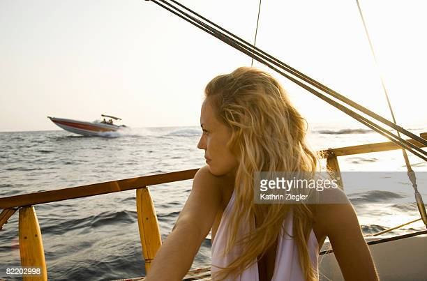 young woman on a sailing boat