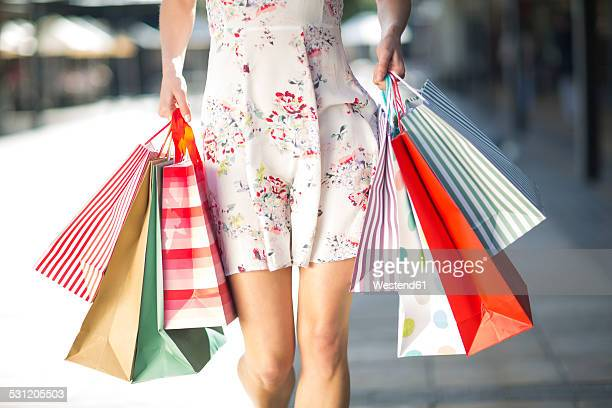 young woman on a shopping spree - shopping bag stock pictures, royalty-free photos & images