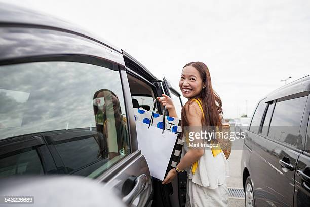 young woman on a shopping trip. - land vehicle stock pictures, royalty-free photos & images