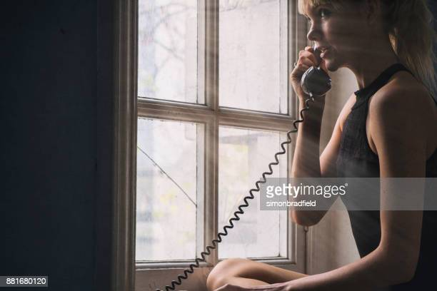 Young Woman On A Telephone
