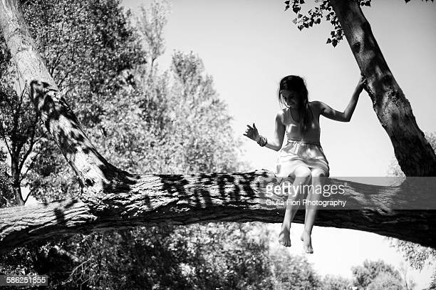 Young woman on a tree