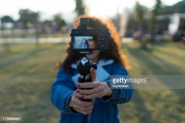 young woman on a vacation vlogging - journalist stock pictures, royalty-free photos & images