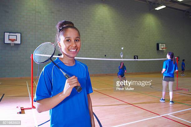 young woman on badminton court, portrait - badminton stock photos and pictures