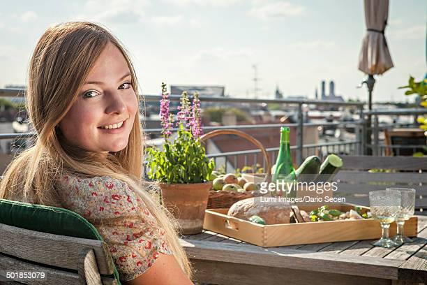 Young Woman On Balcony, Portrait, Munich, Bavaria, Germany, Europe