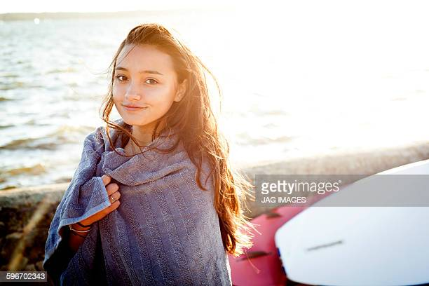 young woman on beach after paddle boarding