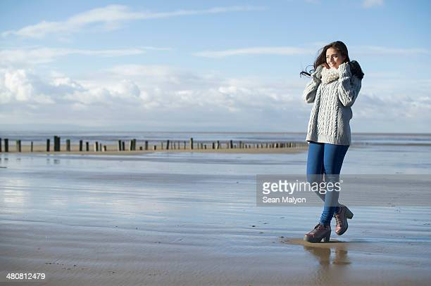 young woman on beach, brean sands, somerset, england - sean malyon stock pictures, royalty-free photos & images