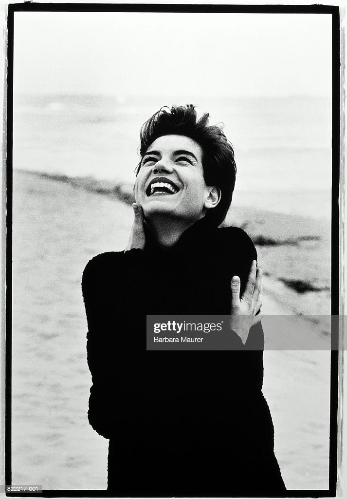 Young woman on beach, laughing (B&W) : Stock Photo