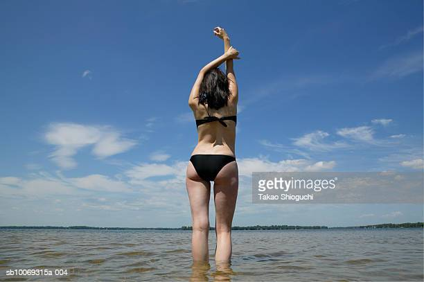 young woman on beach, low angle view - contea di prince edward ontario foto e immagini stock