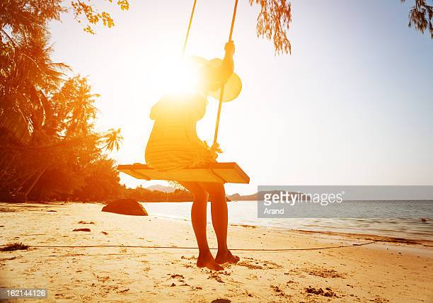 young woman on beach swing