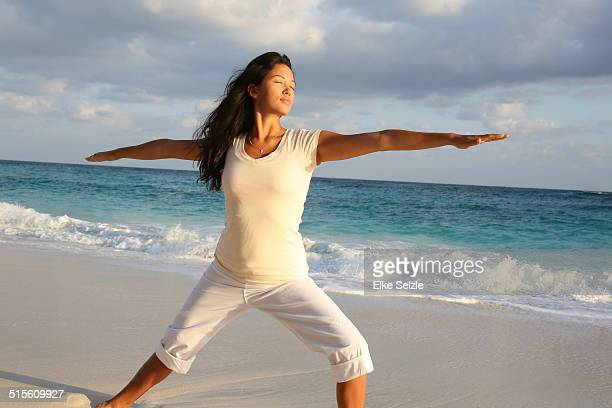 234 Young Woman Practicing Yoga On Beach Paradise Island Nassau Bahamas Photos And Premium High Res Pictures Getty Images