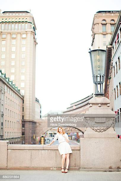 Young woman on bridge, Stockholm, Sweden