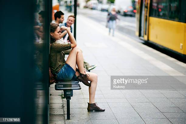 young woman on bus stop - failure stock pictures, royalty-free photos & images