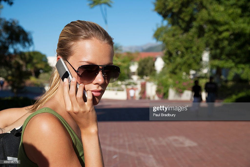 Young woman on cell phone : Stock Photo