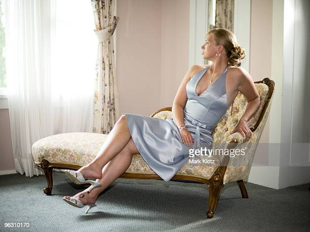 young woman on chaise longue. - chaise longue stock photos and pictures