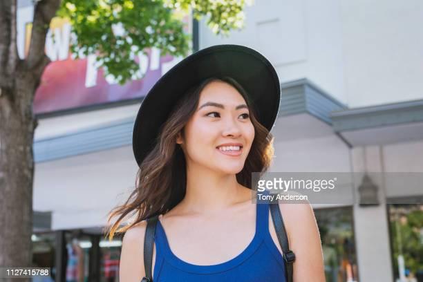 young woman on city street in summer - sin mangas fotografías e imágenes de stock