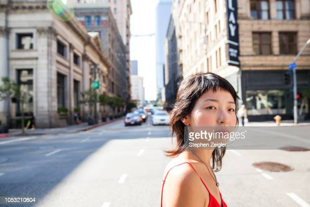 young woman on city street - city of los angeles stock pictures, royalty-free photos & images