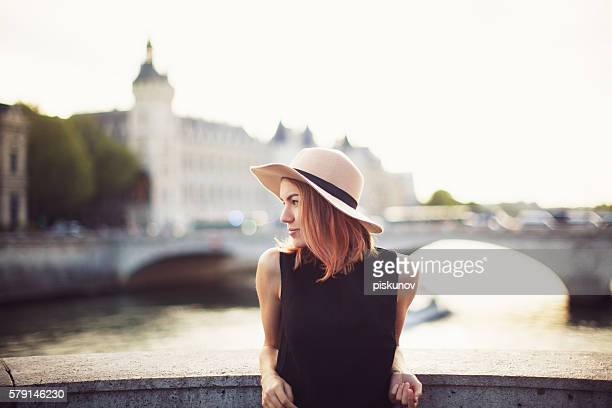 young woman on city street - french women stock photos and pictures