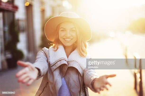 young woman on city street - gesturing stock pictures, royalty-free photos & images