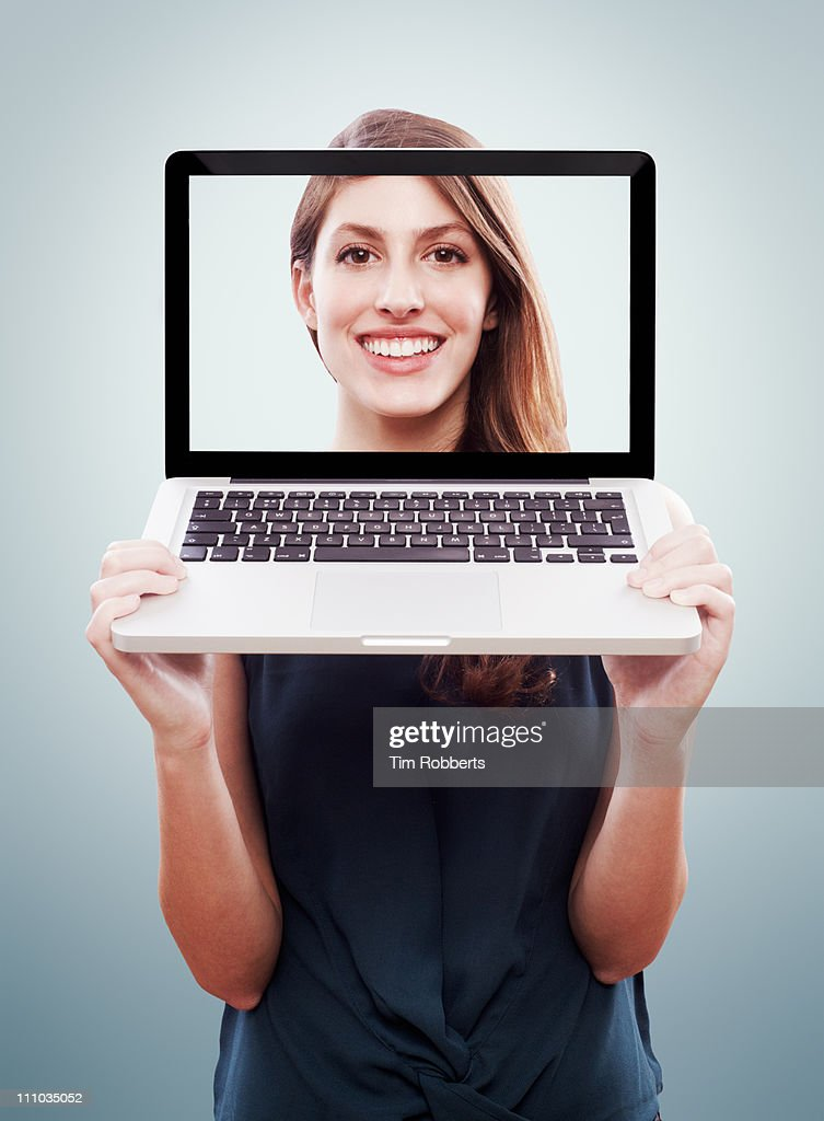Young woman on computer screen. : Stock Photo