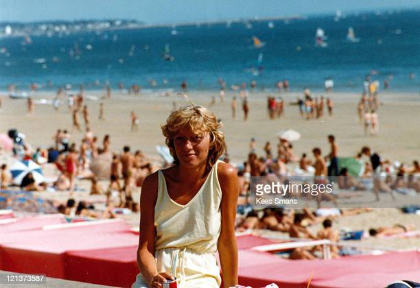 Young woman on crowded beach during vacation