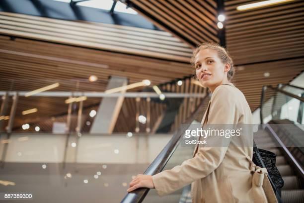Young Woman on Escalator