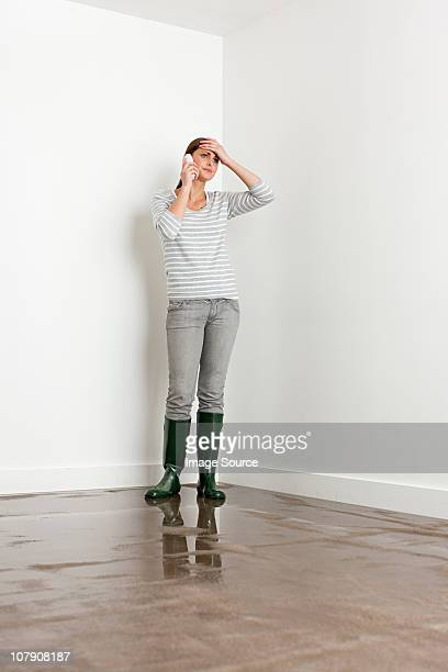 Young woman on flooded floor