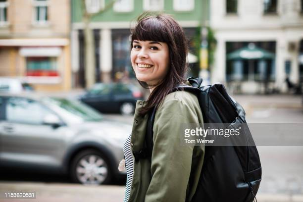 young woman on her way to go shopping - mid adult women stock pictures, royalty-free photos & images